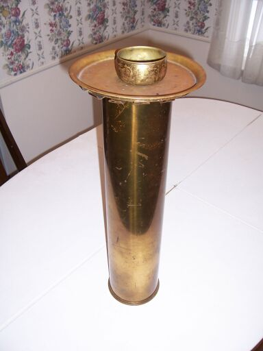 Ash tray with a stand made from an artillery shell casing.